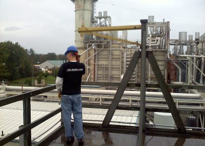 FSG employee Victor working on Cooling tower on roof